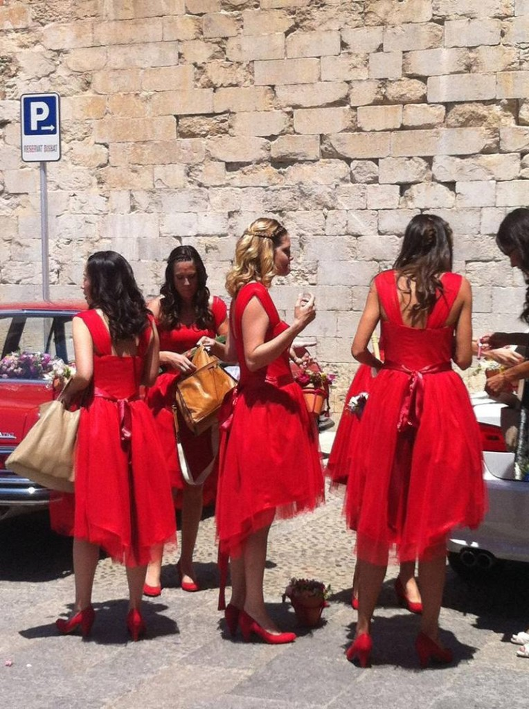 Bridesmaids in red. So cute!!